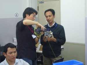 Mr.Kamemura tells Mr.Syahrim how to put parachute on Cansat.